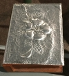 Embossed aluminum on wooden box