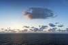 Clouds over peaceful waters